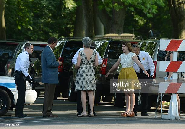 Members of the US Secret Service scan guests arriving to at Valerie Jarrett's house to attend her daughter Laura Jarret's wedding in Chicago Illinois...