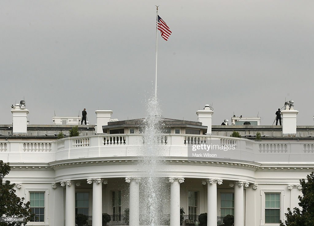 Members of the US Secret Service stand guard on the roof of White House September 30, 2014 in Washington, DC. White House intruder Omar Gonzalez, the man arrested last week after jumping the White House fence, went deeper into the building than what was previously reported.