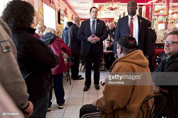 Members of the US Secret Service stand in front of Rick Saccone Republican candidate for the US House of Representatives and Donald Trump Jr...