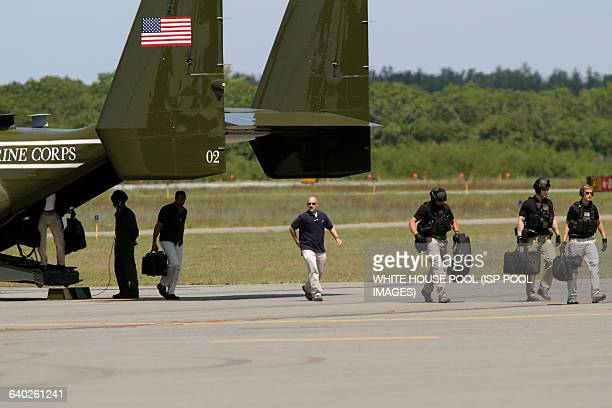 Members of the U.S. Secret Service walk out of a Marine Corp Osprey in advance of the arrival of U.S. President Barack Obama, at the Martha's...