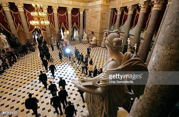 Members of the US Senate escort the Electoral College ballots through Statuary Hall on their way to the House Chamber in the US Capitol January 8...