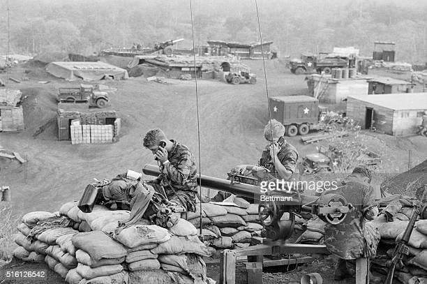 Members of the US Special Forces use field telephones atop a bunker at Duc Lap a hilltop camp near the border of Cambodia The soldiers are...