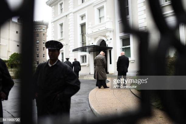 Members of the US State Department Police are seen inside the compound of the Trade Representation building of the Russian Federation on September 2...