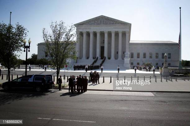 Members of the US Supreme Court police serving as pallbearers carry the casket of the late Associate Justice John Paul Stevens up the steps of the US...