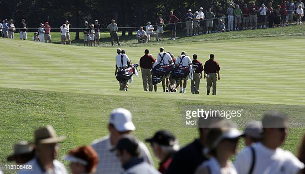 Members of the U.S. Team leave the first hole during a practice round for the 2005 Presidents Cup at the Robert Trent Jones Golf Club in Gainsville,...