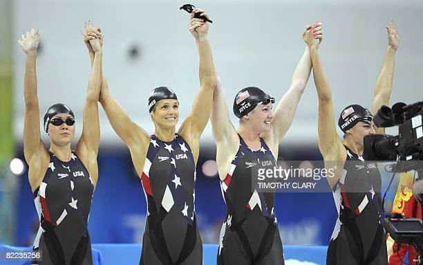Members of the US team Natalie Coughlin Dara Torres Kara Lynn Joyce and Lacey Nymeyer aknowledge the crowd before the women's 4x100m freestyle relay...