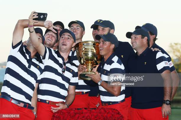 Members of the US Team pose with the trophy after they defeated the International Team 19 to 11 in the Presidents Cup at Liberty National Golf Club...