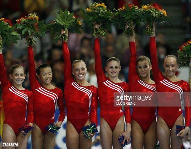 Members of the US team Shawn Johnson Ivana Hong Samantha Peszek Shayla Worley Alicia Sacramone and Anastasia Liukin celebrate after winning the...