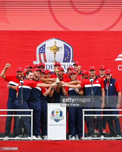 Members of the U.S. Team smile with the trophy following their 19-9 victory during Sunday Singles Matches of the 43rd Ryder Cup at Whistling Straits...