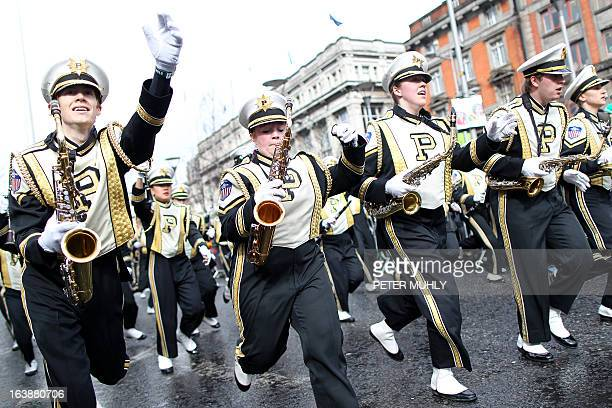 Members of the US University Purdue run along the parade route during St Patrick's Day festivities in Dublin on March 17 2013 More than 100 parades...