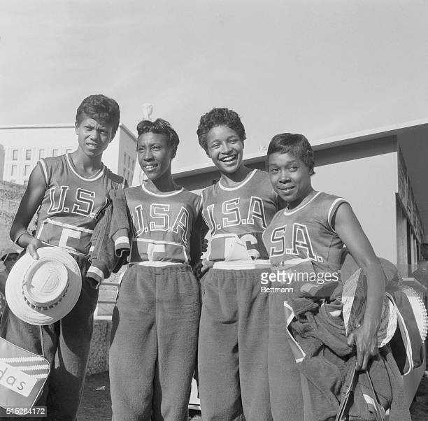 """Members of the U.S. Women's 400-meter relay team, the famed """"Tennessee Tigerbelles,"""" stand together after setting a world record in a winning heat of..."""