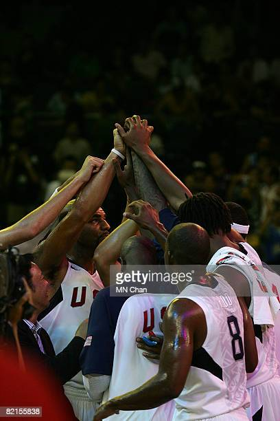 Members of the USA Basketball Men's Senior National Team huddle during the USA Basketball International Challenge exhibition game against the...