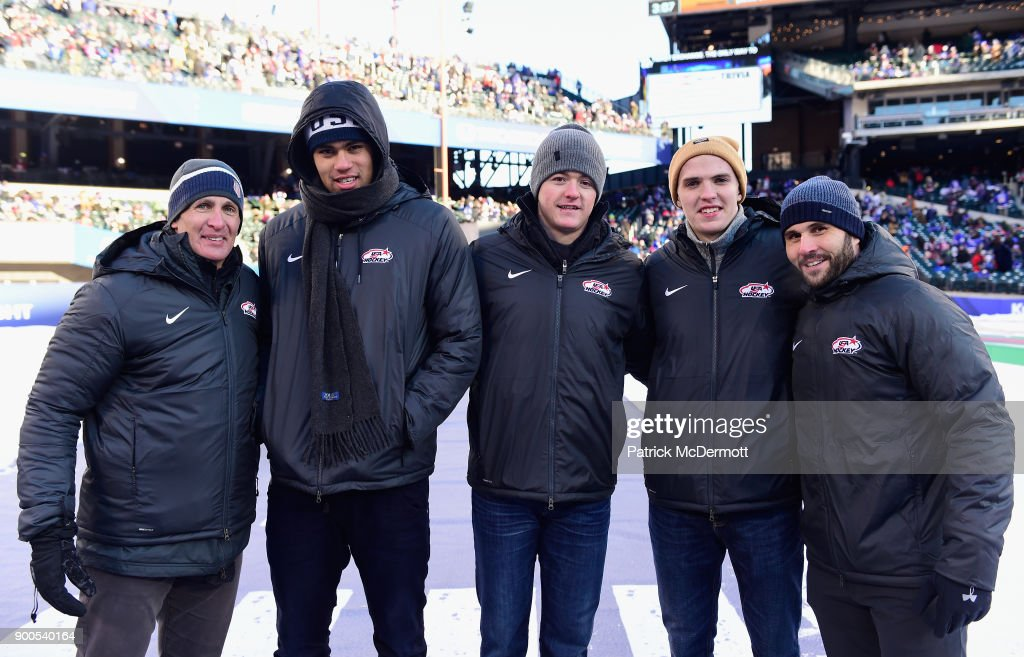 Members of the USA Hockey team, head coach Tony Granato, Jordan Greenway, Ryan Donato, Troy Terry and captain Brian Gionta pose together during the second intermission of the 2018 Bridgestone NHL Winter Classic between the New York Rangers and the Buffalo Sabres at Citi Field on January 1, 2018 in the Flushing neighborhood of the Queens borough of New York City.