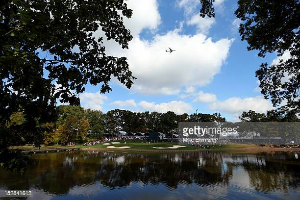 Members of the USA team are seen on the 13th green during a practice round during the fourth preview day of The 39th Ryder Cup at Medinah Country...