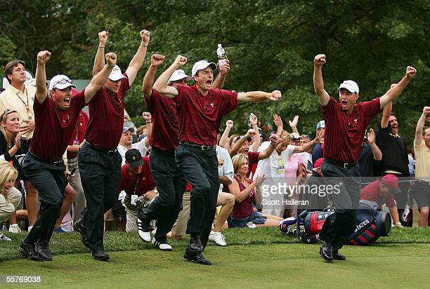 Members of the USA team celebrate after Chris DiMarco made birdie on the 18th hole gave the USA a 185 to 155 victory at the 2005 Presidents Cup on...