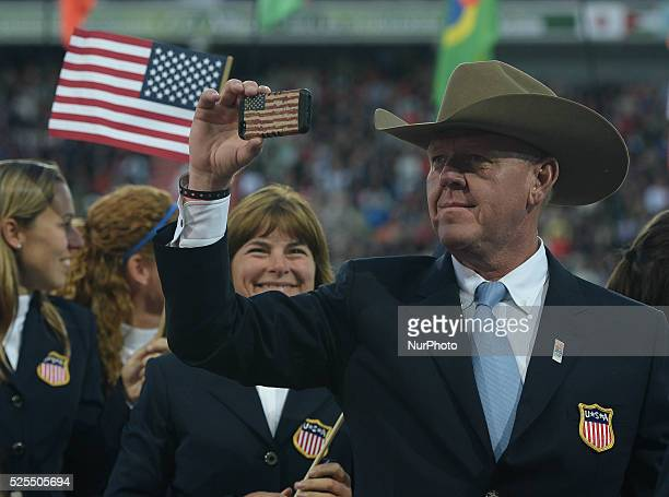 Members of the USA Team during the Parade of Nations at the Opening Ceremony of the ALLTECH FEI WORLD EQUESTRIAN GAMES 2014 at Stade Malherbe in Caen...