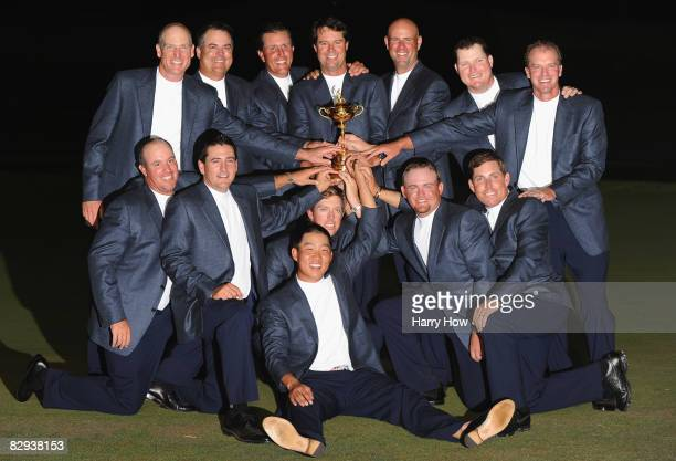 Members of the USA team pose with the Ryder Cup after their 16 1/2-11 1/2 victory over Europe on the final day of the 2008 Ryder Cup at Valhalla Golf...