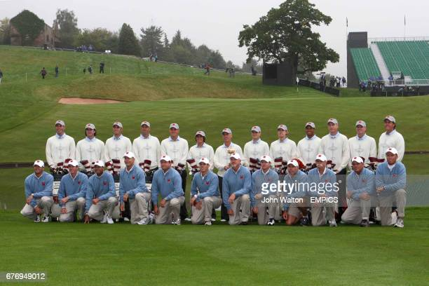Members of the USA team pose with their caddies and the Ryder Cup Trophy Matt Kuchar Bubba Watson Dustin Johnson Stewart Cink Jeff Overton Rickie...