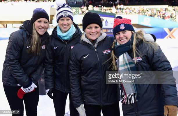 Members of the USA women's hockey team pose together during the second intermission of the 2018 Bridgestone NHL Winter Classic between the New York...