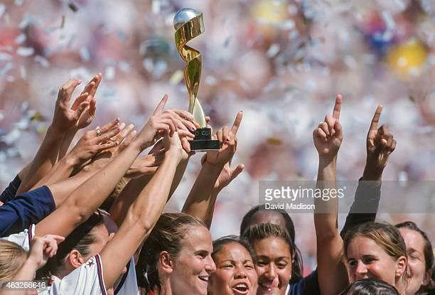 Members of the USA Women's National Team celebrate winning the 1999 FIFA Women's World Cup trophy following the final game played against China on...
