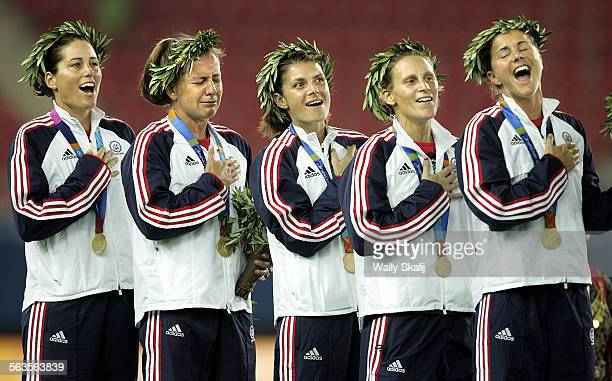 Members of the USA women's soccer team from left Julie Foudy Joy Fawcett Mia Hamm Kristine Lilly and Brandi Chastain sing the national anthem after...