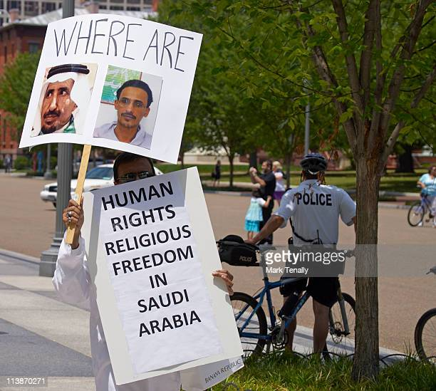 Members of the US-based Center for Democracy and Human Rights in Saudi Arabia, protest Saudi King Abdullah's official state visit to the U.S. White...