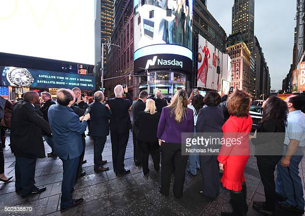 Members of the 'USPS' attend United States Postal Service's Operation Santa To Ring The Nasdaq Stock Market Closing Bell at NASDAQ MarketSite on...