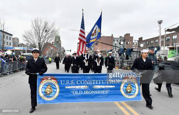 Members of the USS Constitution 'Old Ironsides' participate in the St Patrick's Day Parade on March 19 2017 in Boston Massachusetts