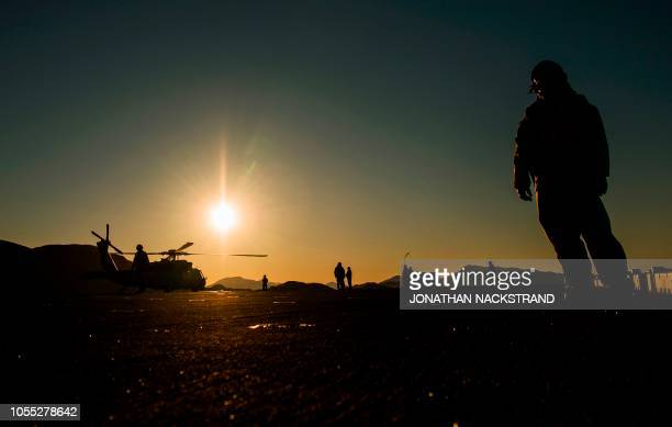 Members of the USS Iwo Jima a Waspclass amphibious assault ship of the United States Navy monitor The Sikorsky SH60 Seahawk a United States Navy...