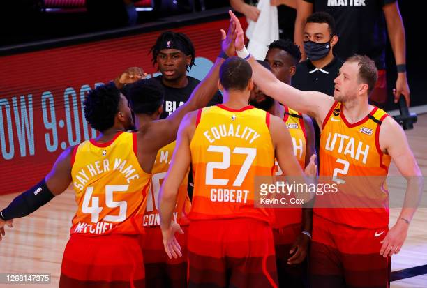 Members of the Utah Jazz celebrate a win against the Denver Nuggets following Game Four of the Western Conference First Round during the 2020 NBA...