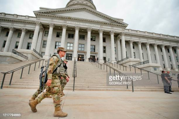 Members of the Utah National Guard patrol the grounds at the Utah State Capitol building waiting for a protest to start in Salt Lake City, Utah on...