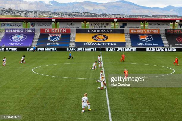 Members of the Utah Royals FC and Houston Dash take a knee in support of the Black Lives Matter movement before a game in the first round of the NWSL...