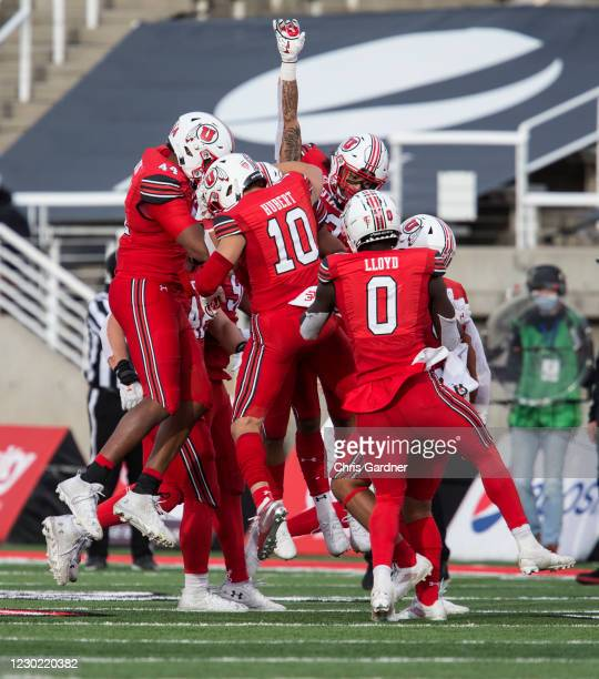 Members of the Utah Utes defense celebrate recovering a fumble in the final seconds of their game against the Washington State Cougars on December...