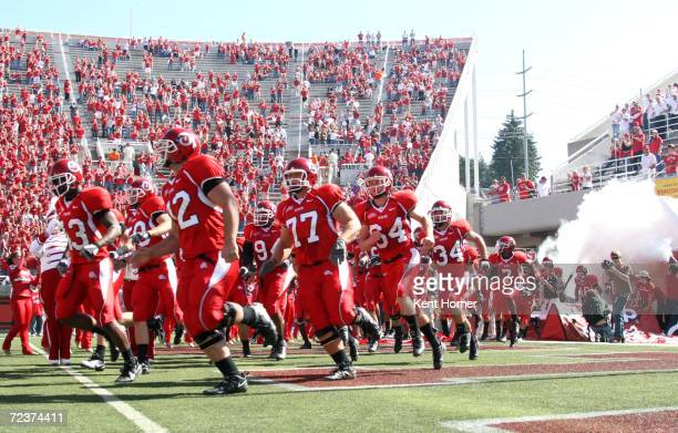 Members of the Utah Utes football team run onto the field prior to the game against Boise State Broncos on Saturday September 30, 2006 during their...