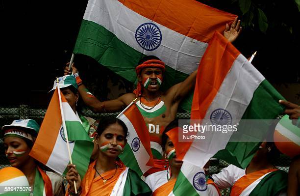 Members of the Vandemataram groups dressed and paints themselves in tricolor as they performing cultural programme like they are singing patriotic...