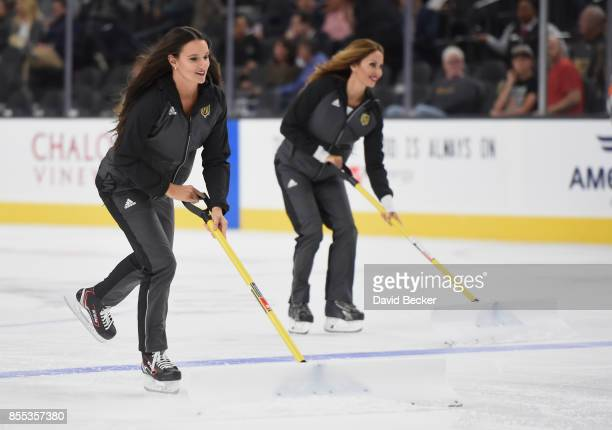 Members of the Vegas Golden Knights ice girls clean the ice during a break in the team's preseason game against the Colorado Avalanche at TMobile...