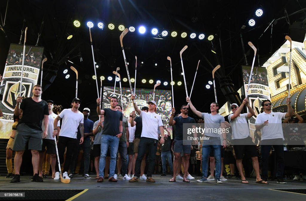 Members of the Vegas Golden Knights, including (L-R) Brayden McNabb #3, Jon Merrill #15, James Neal #18, Malcolm Subban #30, Reilly Smith #19, Cody Eakin #21, Pierre-Edouard Bellemare #41, Erik Haula #56, Nate Schmidt #88 and Alex Tuch #89, hold up hockey sticks during the team's 'Stick Salute to Vegas and Our Fans' event at the Fremont Street Experience on June 13, 2018 in Las Vegas. Nevada. The Golden Knights made it to the Stanley Cup Final in the team's inaugural season, losing to the Washington Capitals four games to one in the series.