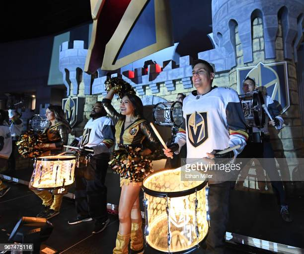 Members of the Vegas Golden Knights Knight Line Drumbots and the Vegas Golden Knights Golden Aces perform in the Castle during a Golden Knights road...
