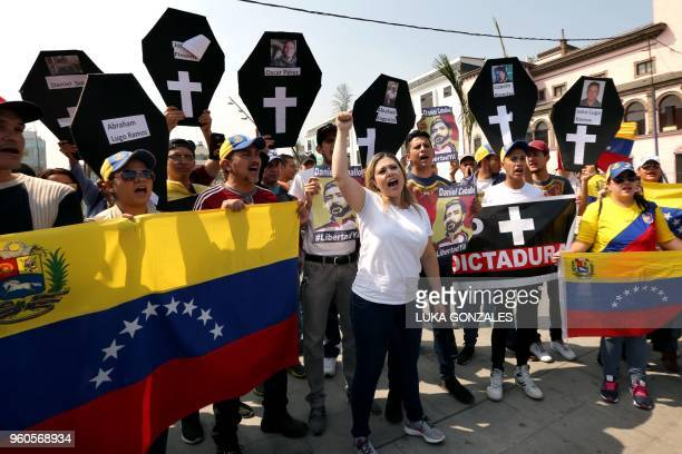 Members of the Venezuelan community in Peru protest against the presidential election in their country in the surroundings of the Venezuelan embassy...