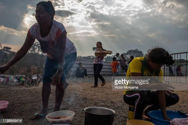Members of the Venezuelan indigenous group Warao prepare food at the Janokoida UN shelter on April 6 2019 in Pacaraima Brazil Venezuelan refugees are...