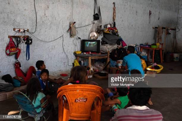 Members of the Venezuelan indigenous group Warao take refuge at the Janokoida UN shelter on April 6 2019 in Pacaraima Brazil Venezuelan refugees are...
