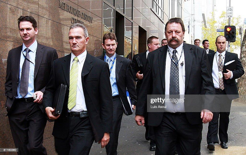 Members of the Victoria Police's Purana Taskforce leave the