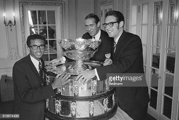 Members of the victorious U.S. Davis Cup team proudly display the coveted, honored symbol of the tennis world's highest accomplishment during a news...