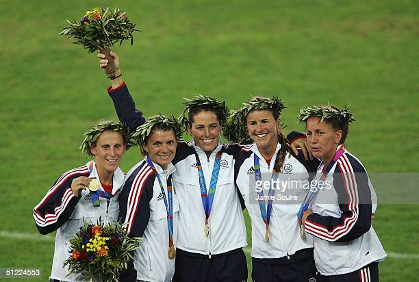 Members of the victorious USA team that beat Brazil 2-1 in extra time stand with their medals on the podium after the women's football match played...
