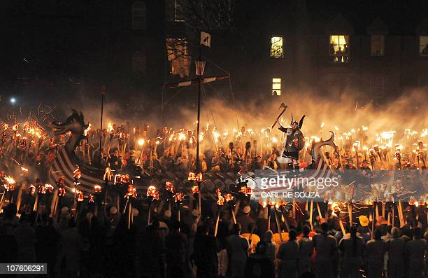 Members of the Viking Jarl Squad surround their leader or Guizer Jarl on a Viking galley ship during the annual Up Helly Aa Festival Lerwick Shetland...