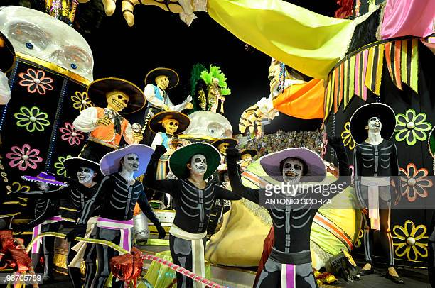 Members of the Viradouro samba school make a representation of the Mexico's 'Day of the Dead' as they perform during the first night of Rio de...