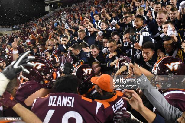 Members of the Virginia Tech Corps of Cadets celebrate with the players following the 6 overtime victory against the North Carolina Tar Heels at Lane...