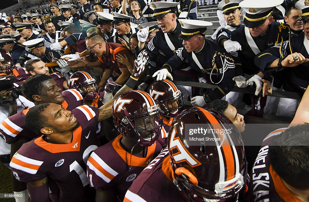 Members of the Virginia Tech Hokies celebrate with the Corps of Cadets following the victory against the Miami Hurricanes at Lane Stadium on October 20, 2016 in Blacksburg, Virginia.