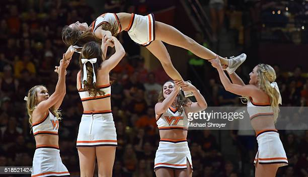 Members of the Virginia Tech Hokies cheerleading squad perform at halftime of the game against the Princeton Tigers at Cassell Coliseum on March 16...