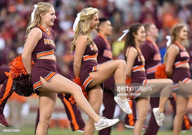 Members of the Virginia Tech Hokies cheerleading squad perform the Hokie Pokey during the game against the Duke Blue Devils at Lane Stadium on...